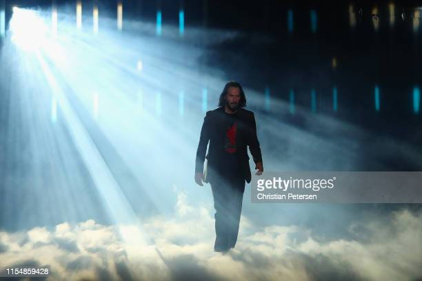 Actor Keanu Reeves walks on stage to speak about Cyberpunk 2077 from developer CD Projekt Red during the Xbox E3 2019 Briefing at The Microsoft...