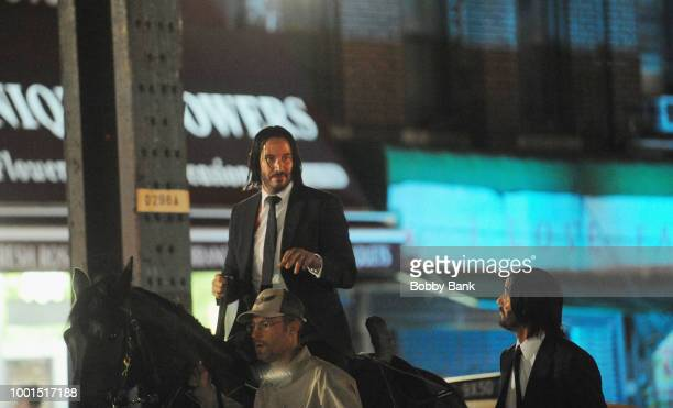 Actor Keanu Reeves with his stunt double on the set of John Wick 3 Parabellum on July 18 2018 in Brooklyn NY