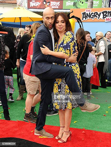 Actor KeeganMichael Key and actress Maya Rudolph attend the premiere of 'Angry Birds' at Regency Village Theatre on May 7 2016 in Westwood California