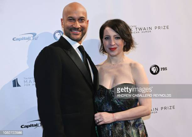 Actor KeeganMichael Key and his wife producer Elisa Pugliese pose on the red carpet for the 21st Annual Mark Twain Prize for American Humor at the...