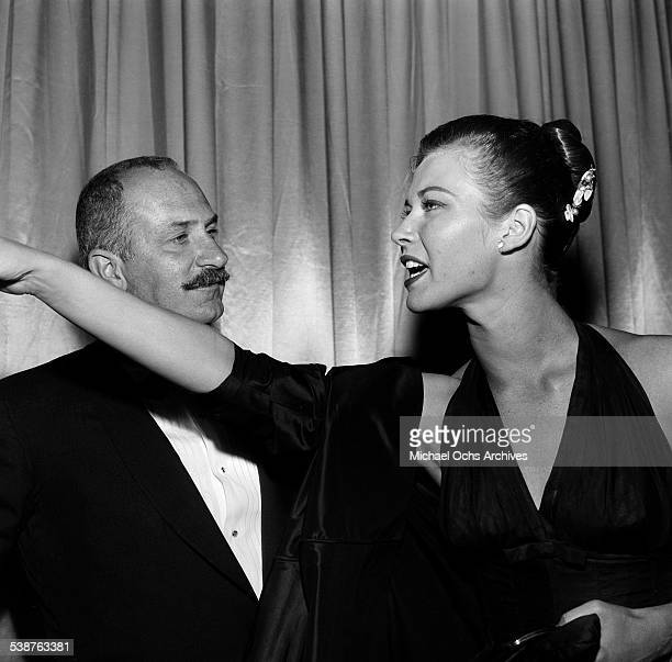Actor Keenan Wynn and actress Gia Scala attend the premiere of 'Designing Woman' in Los AngelesCA