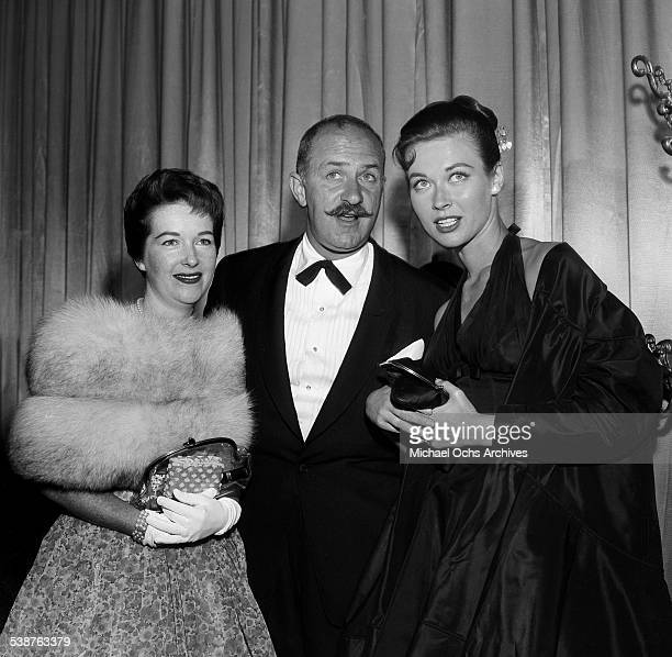 Actor Keenan Wynn and his wife Sharley Hudson with actress Gia Scala attend the premiere of 'Designing Woman' in Los AngelesCA