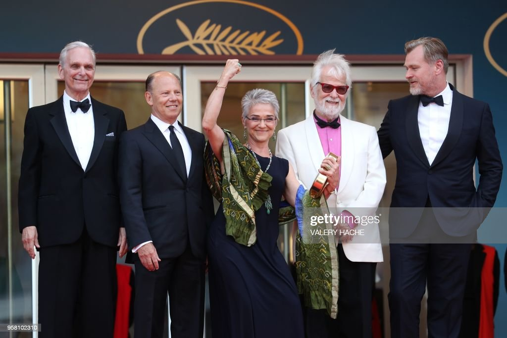 US actor Keir Dullea, a guest, Katharina Kubrick, daughter of British director Stanley Kubrick, German-US producer Jan Harlan and British director Christopher Nolan pose as they arrive on May 13, 2018 for the screening of a remastered version of the film '2001: A Space Odyssey' at the 71st edition of the Cannes Film Festival in Cannes, southern France.