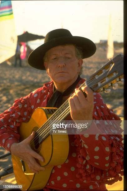 Actor Keith Barron dressed in a Spanish flamenco outfit as his character David Pearce in the Christmas special episode of sitcom Duty Free, circa...