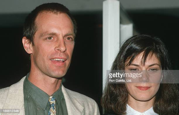 Actor Keith Carradine and date Linda Fiorentino attending the premiere of The Moderns on April 7 1988 at Lincoln Center in New York City New York
