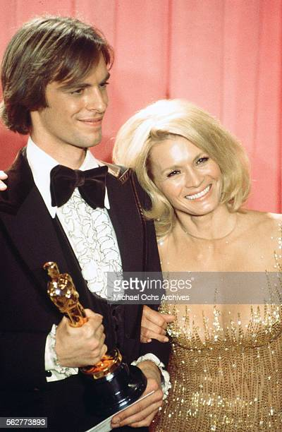 Actor Keith Carradine poses backstage after winning 'Best Original Song' with actress Angie Dickinson during the 48th Academy Awards at Dorothy...