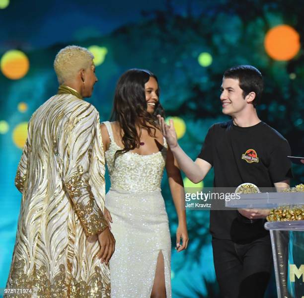Actor Keiynan Lonsdale accepts award from Alisha Boe and Dylan Minnette onstage at the 2018 MTV Movie And TV Awards at Barker Hangar on June 16 2018...