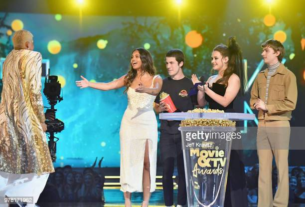 Actor Keiynan Lonsdale accepts award from Alisha Boe Dylan Minnette Katherine Langford and Miles Heizer onstage at the 2018 MTV Movie And TV Awards...