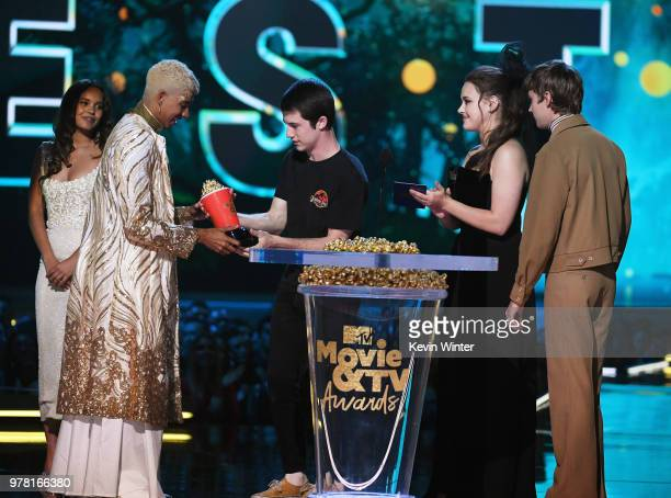 Actor Keiynan Lonsdale accepts the Best Kiss award for 'Love Simon' from actors Alisha Boe Dylan Minnette Katherine Langford and Miles Heizer onstage...