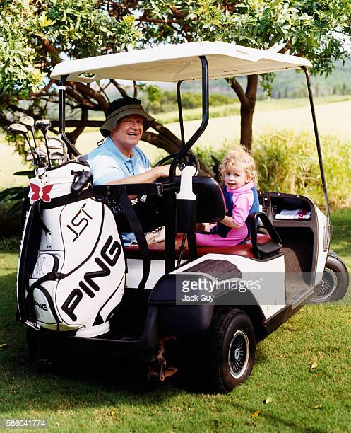 Actor Kelsey Grammer is photographed for InStyle Magazine in 2004 at home in Maui Grammer gives his daughter Mason a ride at a golf course near his...