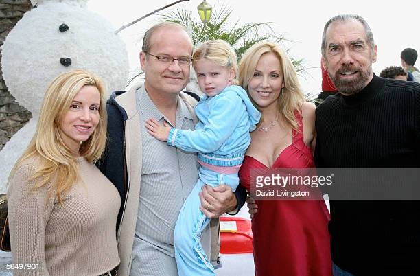 Actor Kelsey Grammer poses with his wife, Camille ), daughter Mason Olivia, Eloise DeJoria and her husband John Paul DeJoria, CEO and co-founder of...