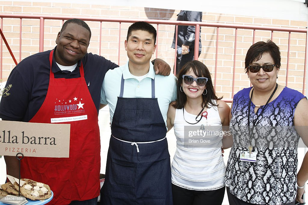 Actor Kelvin Brown poses with guests at the Hollywood Chamber Of Commerce Annual Police And Fire BBQ on August 27, 2014 in Hollywood, California.