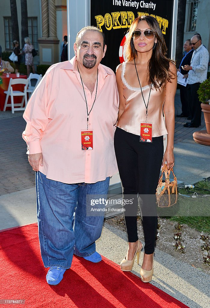 Actor Ken Davitian (L) and actress Wedil David arrive at The Children's Charity Of Southern California Texas Hold 'Em Poker Tournament hosted by Variety at Paramount Studios on July 17, 2013 in Los Angeles, California.