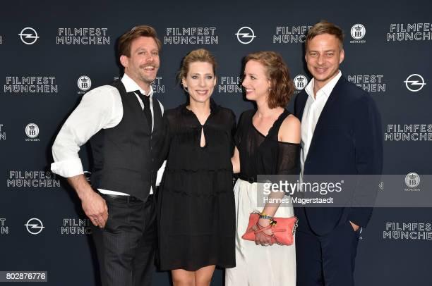 Actor Ken Duken, his wife Marisa Leonie Bach, Amelie Plaas-Link and Tom Wlaschiha attend the 'Berlin Fallen' Premiere during Munich Film Festival...