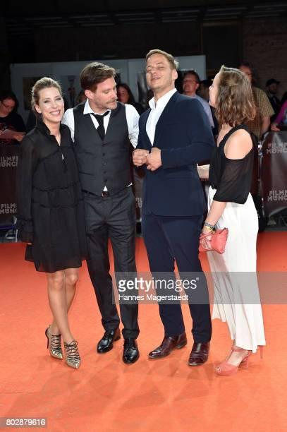 Actor Ken Duken, his wife Marisa Leonie Bach , Amelie Plaas-Link and Tom Wlaschiha attend the 'Berlin Fallen' Premiere during Munich Film Festival...