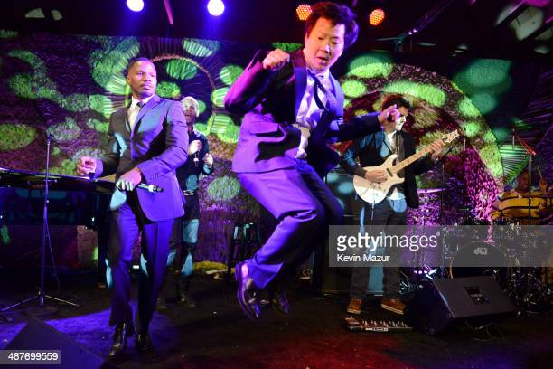 Actor Ken Jeong actorsinger Jamie Foxx and singer/songwriter John Mayer perform onstage during Hollywood Stands Up To Cancer Event with contributors...