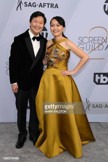 Actor Ken Jeong and his wife Tran arrive for the 25th Annual Screen Actors Guild Awards at the Shrine Auditorium in Los Angeles on January 27 2019