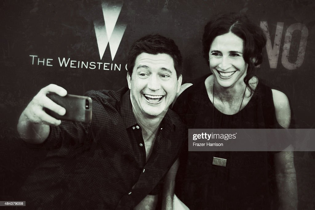 . Actor Ken Marino and actress Michaela Watkins arrive at The Premiere Of The Weinstein Company's 'No Escape' at Regal Cinemas L.A. Live on August 17, 2015 in Los Angeles, California.