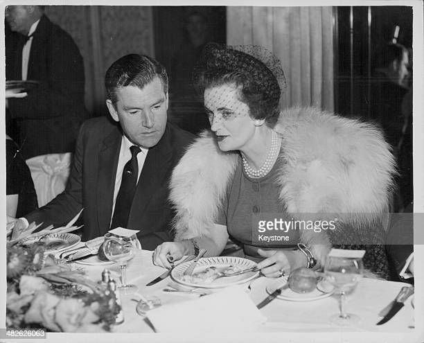 Actor Kenneth More talking to the Duchess of Argyll at a Foyles Literary Luncheon at the Dorchester Hotel London December 18th 1959