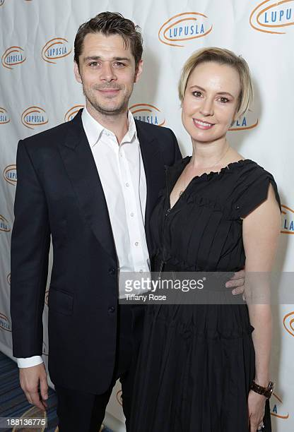 Actor Kenny Doughty and actress Caroline Carver attend the Hollywood Bag Ladies Luncheon on November 15, 2013 in Beverly Hills, California.