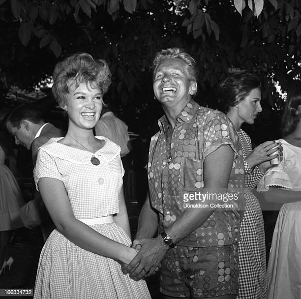 Actor Kenny Miller and friend at a pool party at Dick Clark's house in 1965 in Los Angeles California