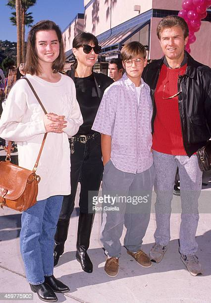 Actor Kent McCord wife Cynthia Lee Doty daughter Megan McCord and son Michael McCord attend 'The Wizard' Universal City Premiere on December 2 1989...
