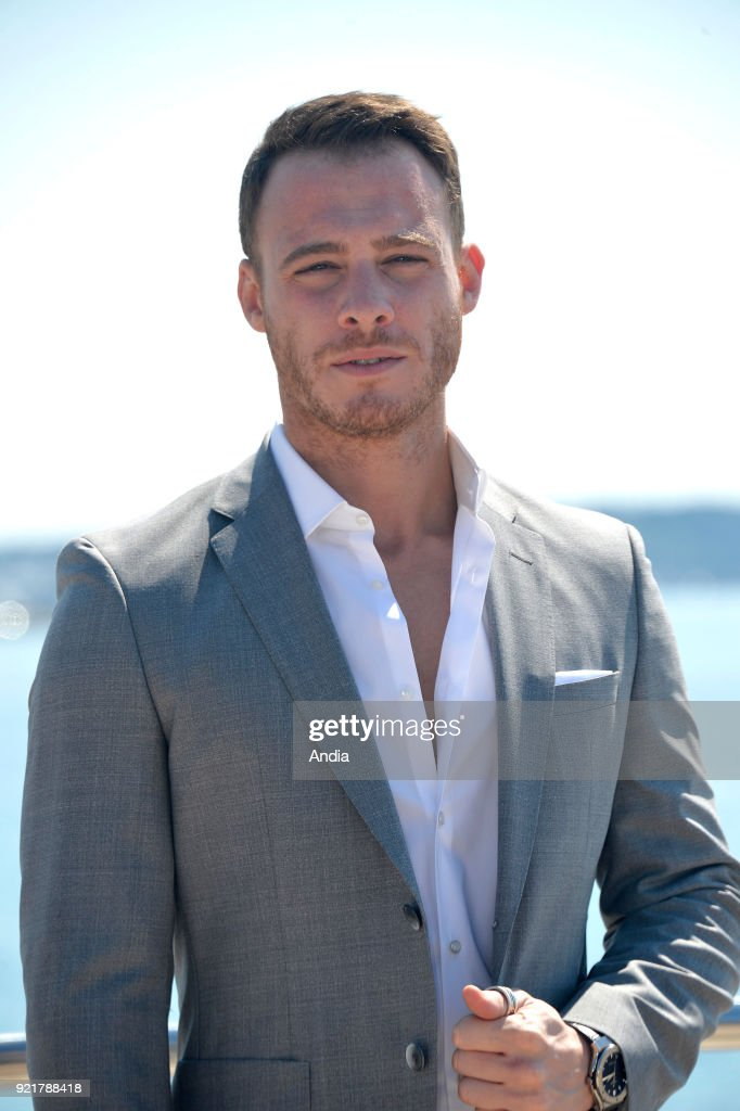 Actor Kerem Bursin posing for a photocall on the occasion of the MipTV, International Television Programme Market, in Cannes (south-eastern France) on .