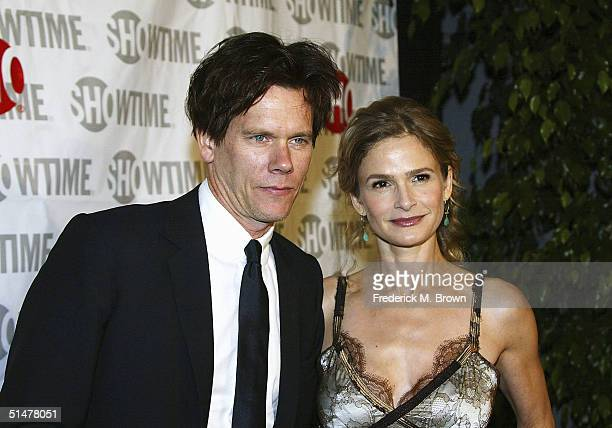 Actor Kevin Bacon and actor/executive producer Kyra Sedgwick attend the film premiere of Cavedweller at the Harmony Gold Theatre on October 13 2004...