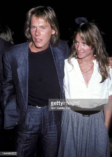 Actor Kevin Bacon and actress Tracy Pollan attend the Top Gun New York City Premiere on May 12 1986 at Loews Astor Plaza in New York City
