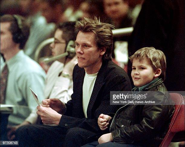 Actor Kevin Bacon and his son Travis take in the action as the New York Knicks take on the Milwaukee Bucks at Madison Square Garden