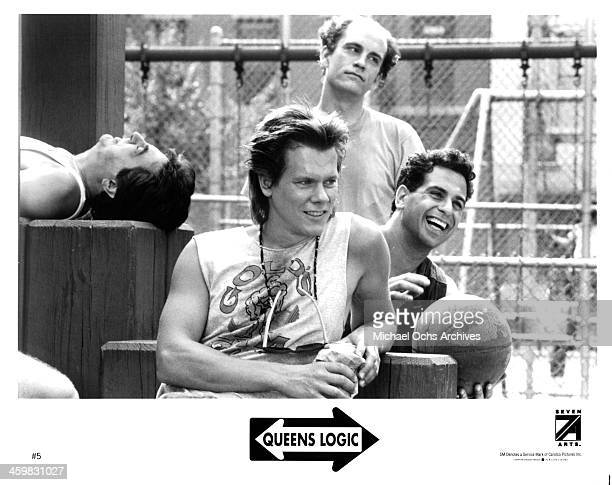 Actor Kevin Bacon Joe Mantegna John Malkovich and Ken Olin on set of the movie 'Queens Logic' circa 1991