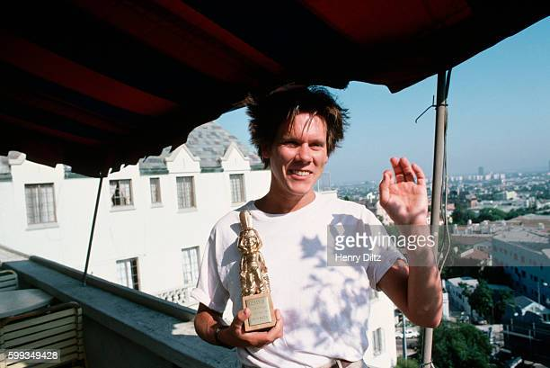 Actor Kevin Bacon shows off the Bravo award for his acting talents He became teen idol in the 1980s for his major role in the film 'Footloose'
