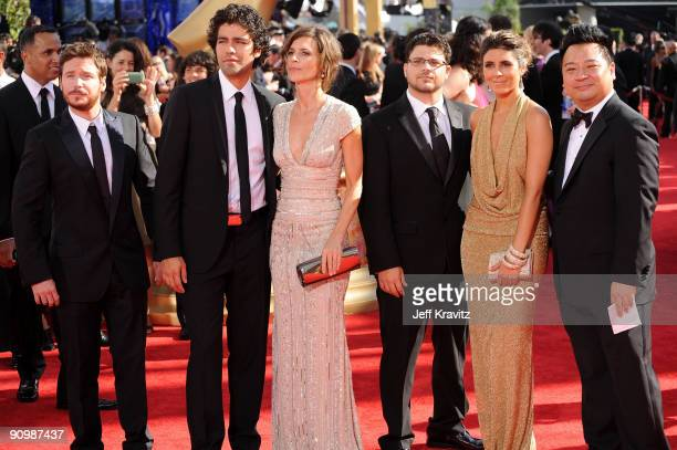 Actor Kevin Connolly, actor Adrian Grenie and guest, actor Jerry Ferrara and guest and actor Rex Lee arrive at the 61st Primetime Emmy Awards held at...