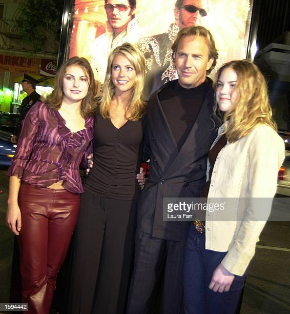 Actor Kevin Costner accompanies his girlfriend Christine Baumgartner second from left and his daughters Annie left and Lily right at the premiere of...
