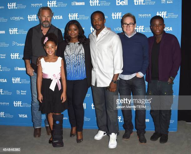 Actor Kevin Costner actress Jillian Estell actress Octavia Spencer actor Anthony Mackie director Mike Binder and actor Mpho Koaho poses at Black And...