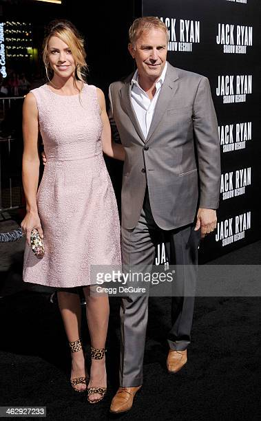 """Actor Kevin Costner and Christine Baumgartner arrive at the Los Angeles premiere of """"Jack Ryan: Shadow Recruit"""" at TCL Chinese Theatre on January 15,..."""