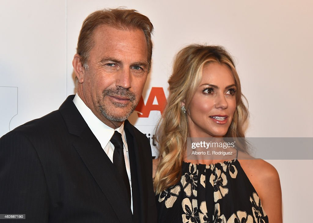 Actor Kevin Costner and Christine Baumgartner arrive to AARP The Magazine's 14th Annual Movies For Grownups Awards Gala at the Beverly Wilshire Four Seasons Hotel on February 2, 2015 in Beverly Hills, California.