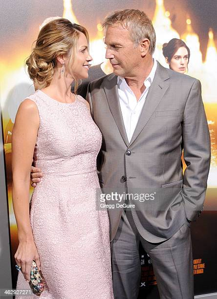 """Actor Kevin Costner and Christine Baumgartner arrives at the Los Angeles premiere of """"Jack Ryan: Shadow Recruit"""" at TCL Chinese Theatre on January..."""