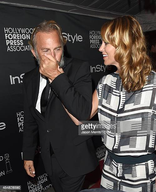 Actor Kevin Costner and Christine Baumgartner attend HFPA InStyle's 2014 TIFF celebration during the 2014 Toronto International Film Festival at...