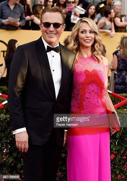 Actor Kevin Costner and Christine Baumgartner attend the 21st Annual Screen Actors Guild Awards at The Shrine Auditorium on January 25, 2015 in Los...