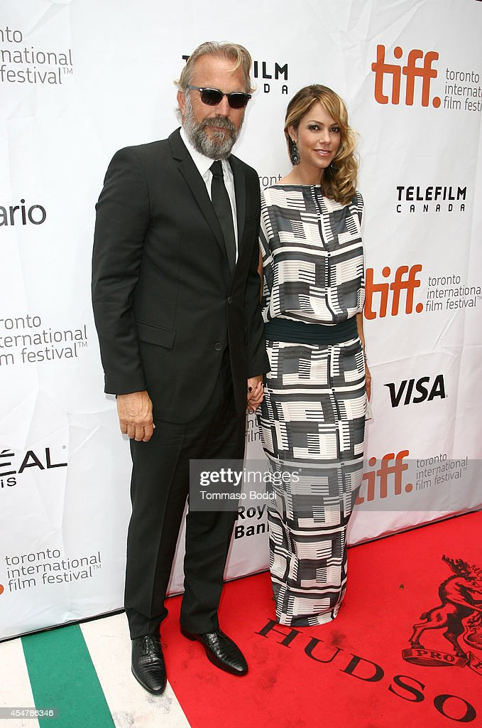 Actor Kevin Costner (L) and Christine Baumgartner attend the 'Black And White' premiere during the 2014 Toronto International Film Festival at Roy Thomson Hall on September 6, 2014 in Toronto, Canada.