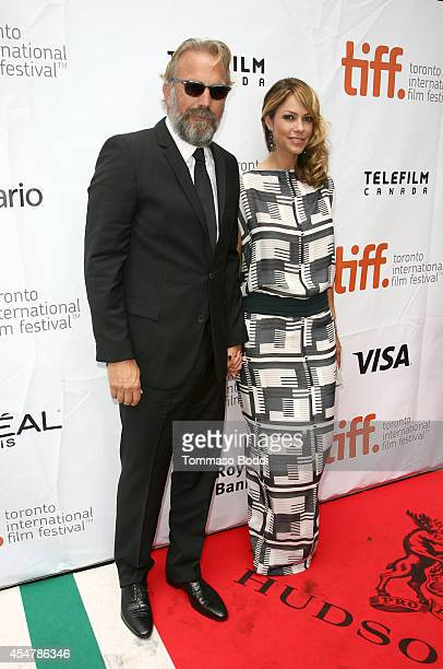 Actor Kevin Costner and Christine Baumgartner attend the Black And White premiere during the 2014 Toronto International Film Festival at Roy Thomson...