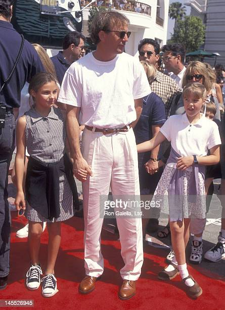 Actor Kevin Costner and daughters Annie and Lily Costner attend the Flipper Universal City Premiere on May 5 1996 at the Cineplex Odeon Universal...