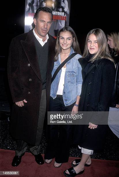 Actor Kevin Costner and daughters Annie and Lily Costner attend the Play It to the Bone Hollywood Premiere on January 10 2000 at the El Capitan...