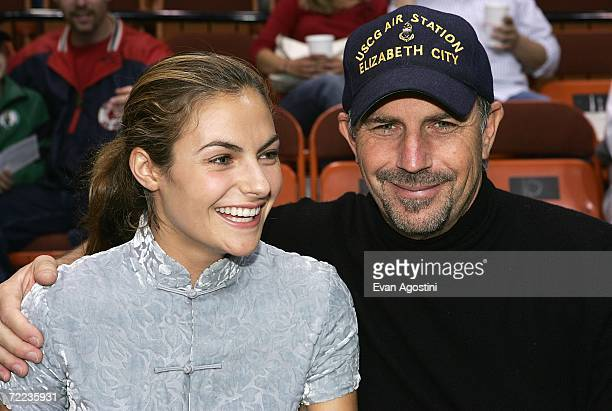 Actor Kevin Costner and his daughter Annie Costner sit courtside at the New York Knicks v Boston Celtics preseason game during the Mohegan Sun 10th...