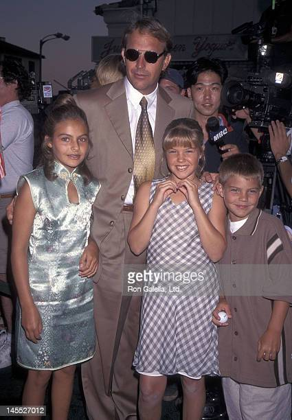 Actor Kevin Costner and kids Annie Lily and Joe Costner attend the Tin Cup Westwood Premiere on August 1 1996 at the Mann Village Theatre in Westwood...