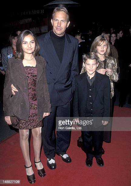 Actor Kevin Costner and kids Annie Lily and Joe Costner attend The Postman Burbank Premiere on December 12 1997 at the Steven J Ross Theatre Warner...