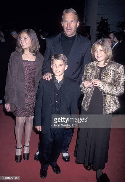 Actor Kevin Costner and kids Annie Lily and Joe Costner attend 'The Postman' Burbank Premiere on December 12 1997 at the Steven J Ross Theatre Warner...