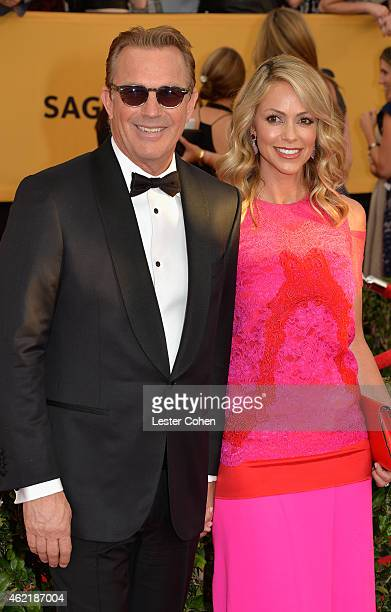 Actor Kevin Costner and model Christine Baumgartner attend the 21st Annual Screen Actors Guild Awards at The Shrine Auditorium on January 25 2015 in...