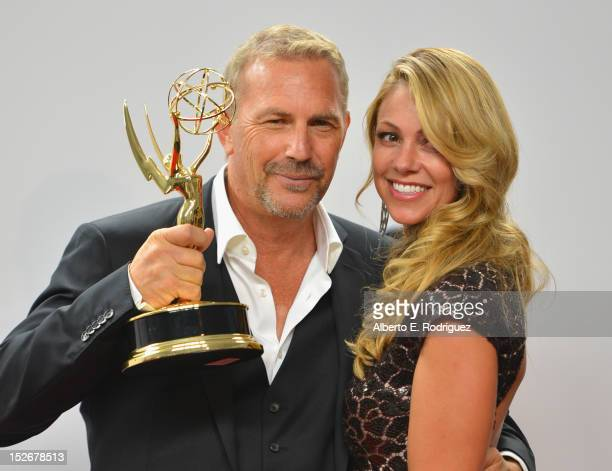 Actor Kevin Costner and wife Chistine Baumgartner pose in the 64th Annual Emmy Awards press room at Nokia Theatre LA Live on September 23 2012 in Los...